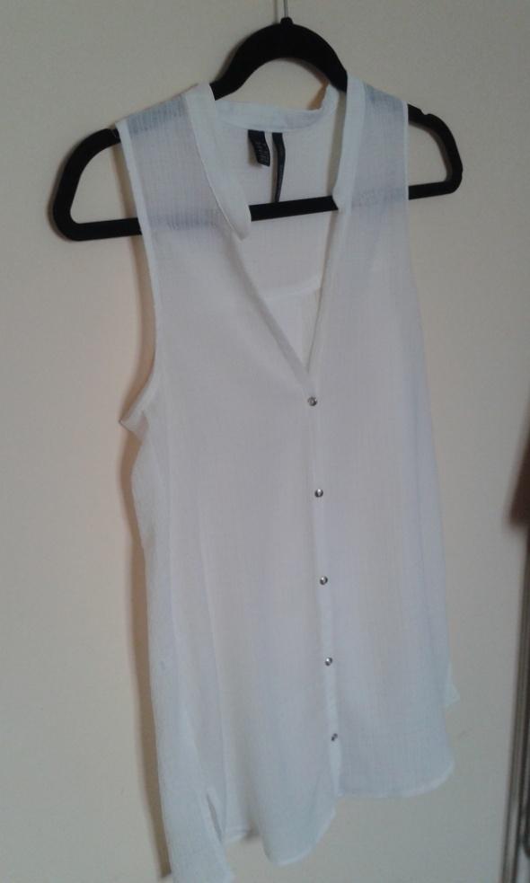 piękna kremowa bluzka marki Mango...