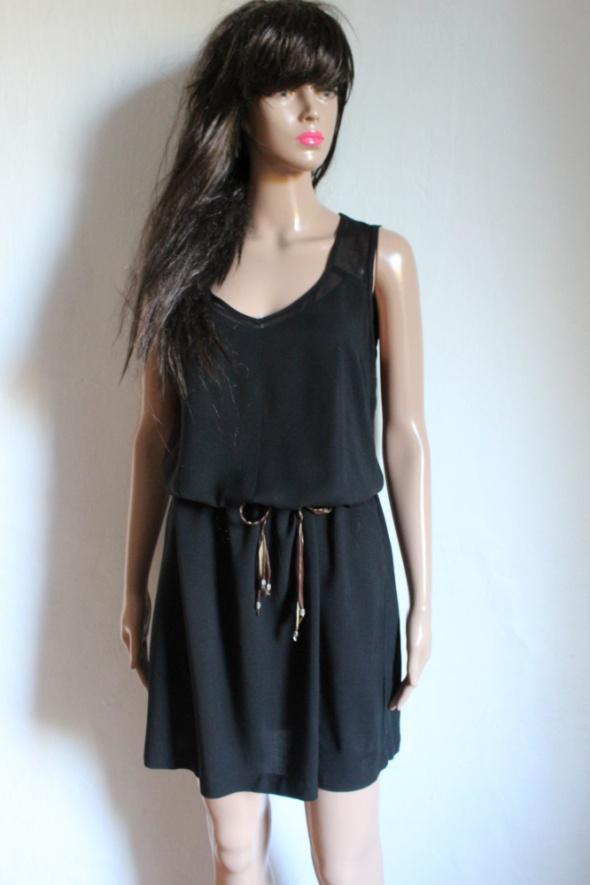 Czarna prosta sukienka lejąca r około ML...