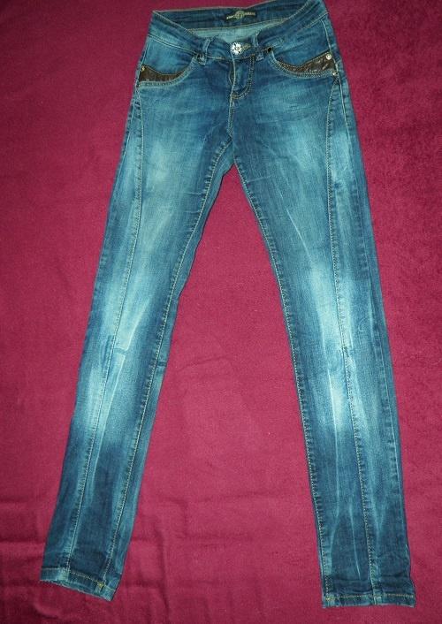 Spodnie jeansy Versace...