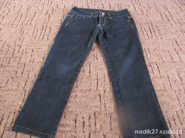 Granatowe jeansy rozmiar S tanio...