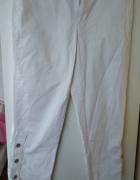 Białe spodnie trzyczwarte...