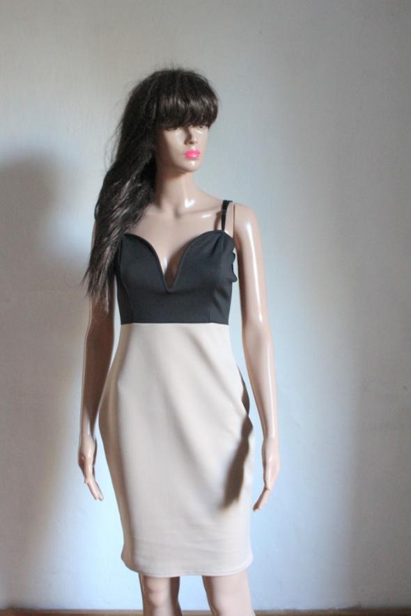 Dopasowana elegancka sukienka r S...