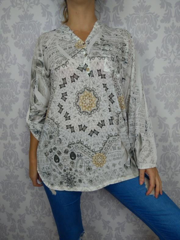 Śliczna biała delikatna bluzka we wzory