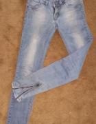 Jeansy rurki z suwakami na nogawkach W31L34...