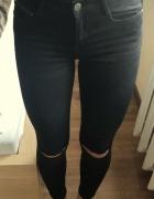 Wyprzedaż czarne jeansy cropp...