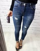Świetne ciemne jeansy rurki z dziurami rozm S...