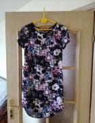 Modna koktajlowa sukienka w kwiaty o luźnym kroju Rozmiar 34