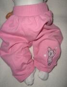 Disney różowe spodnie dresowe roz 9 12 msc...