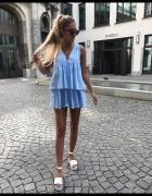 Nowy niebieski kombinezon w paski Zara M...