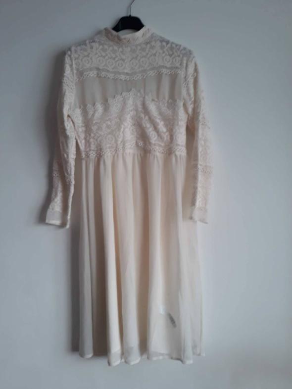 nowa kremowa sukienka midi...