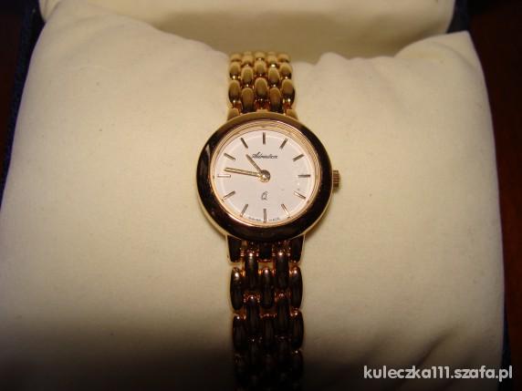 Pozłacany nowy szwajcarski zegarek