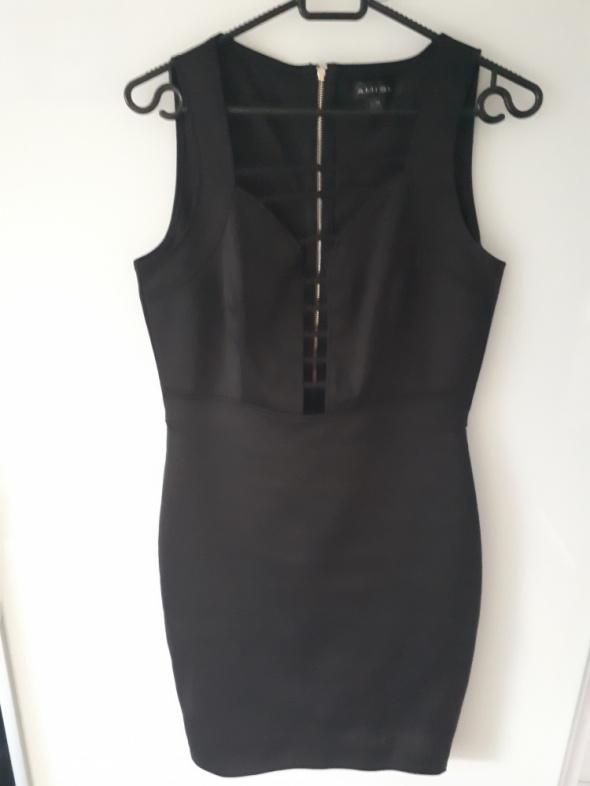 sukienka dopasowana ołówkowa z wycięciami mini...