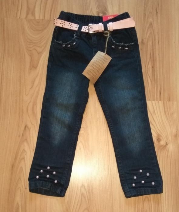 Nowe dziewczęce spodnie jeansowe z różówymi perełkami na nogawkach 104