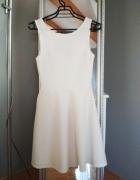 rozkloszowana sukienka złamana biel H&M...
