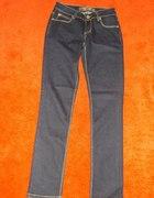 Ciemne klasyczne jeansy Dromedar 28...