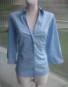 Elegancka błękitna koszula damska XL...