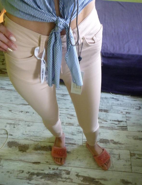 pudrowe rurki skinny fit vero moda wysoki stan...