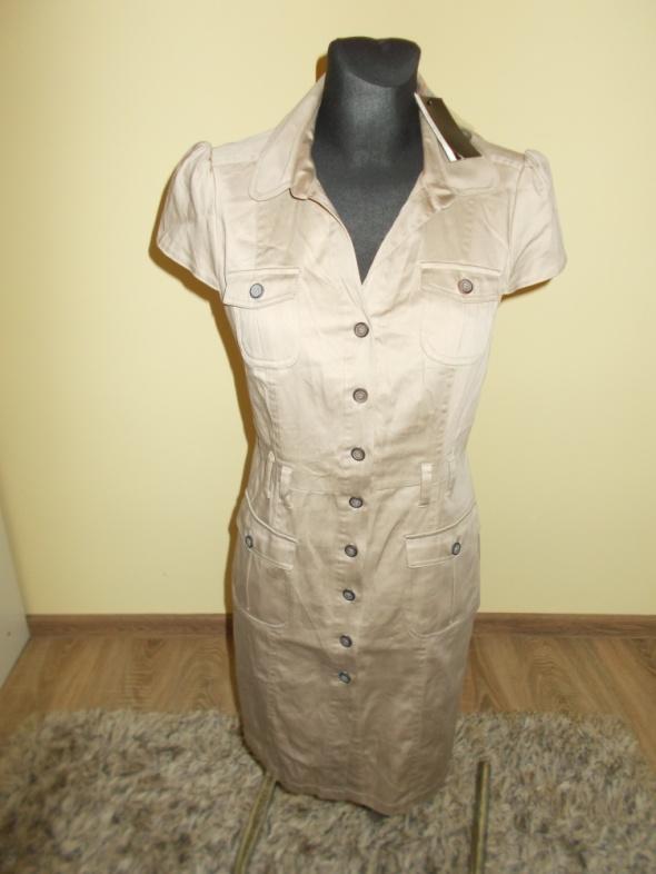 Nowa sukienka pensjonarka Atmospere 38
