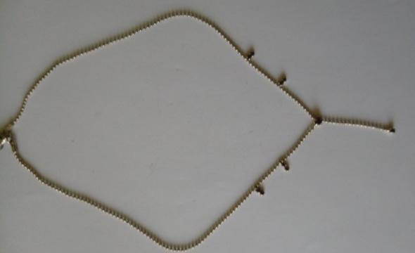 srebrny łańcuszek z dronymi cyrkoniami fioletowe