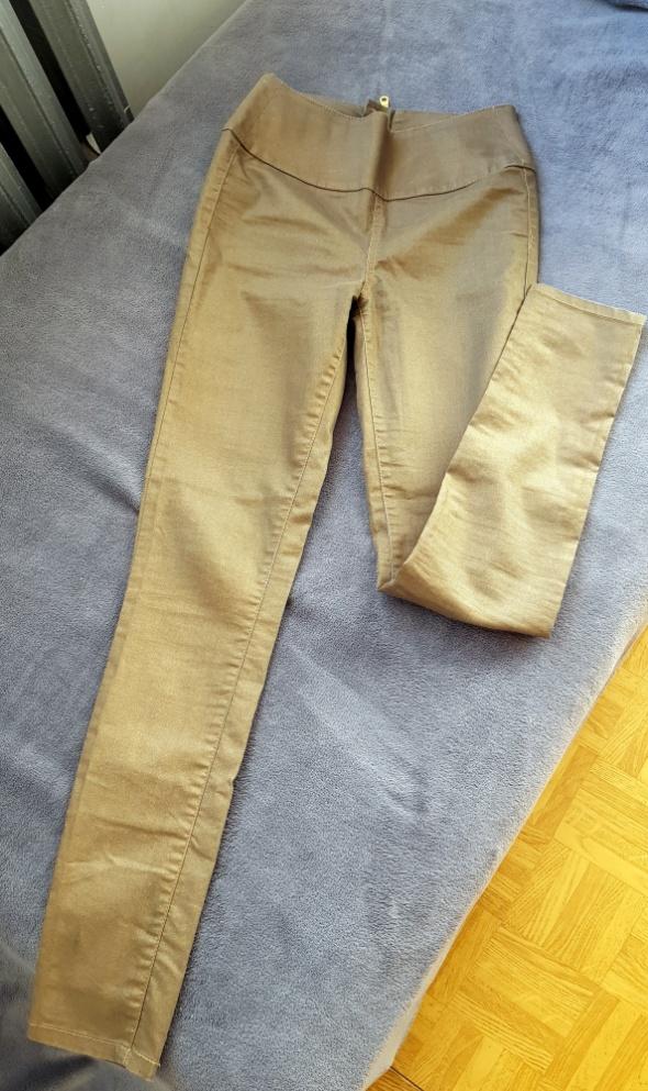 Spodnie złote rurki z suwakiem pieces...