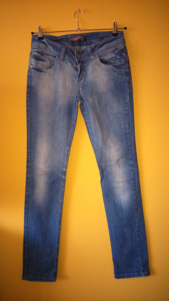 Jasne przecierane jeansy Troll