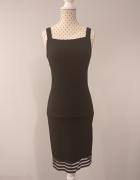 czarna sukienka ze zdobieniem na dole...