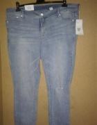 H&M Niebieskie jeansy rurki skinny z dziurami 52...