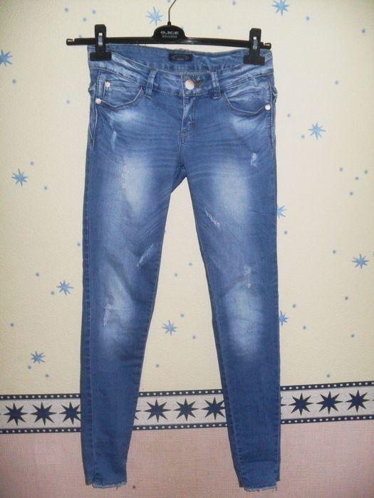 Spodnie rurki slim jeansy jeans przecierane kokardki 36S