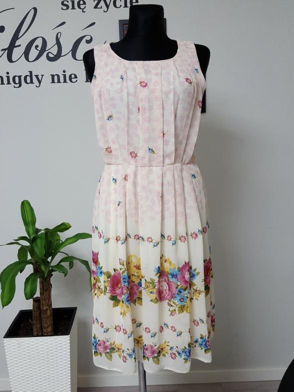 kremowo rózowa sukienka w kwiaty Atmosphere...