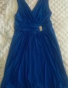 sukienka z ozdobą...
