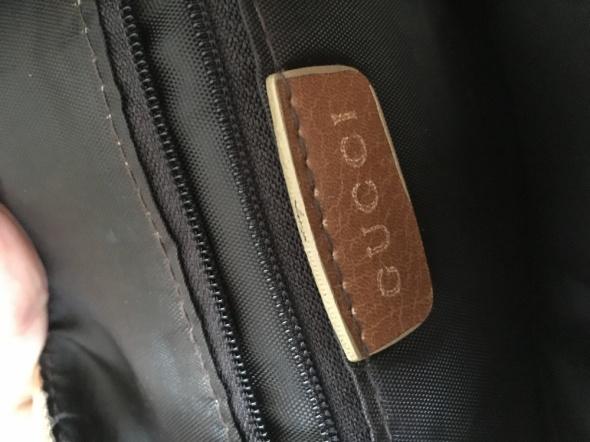 Skórzana torebka gucci...