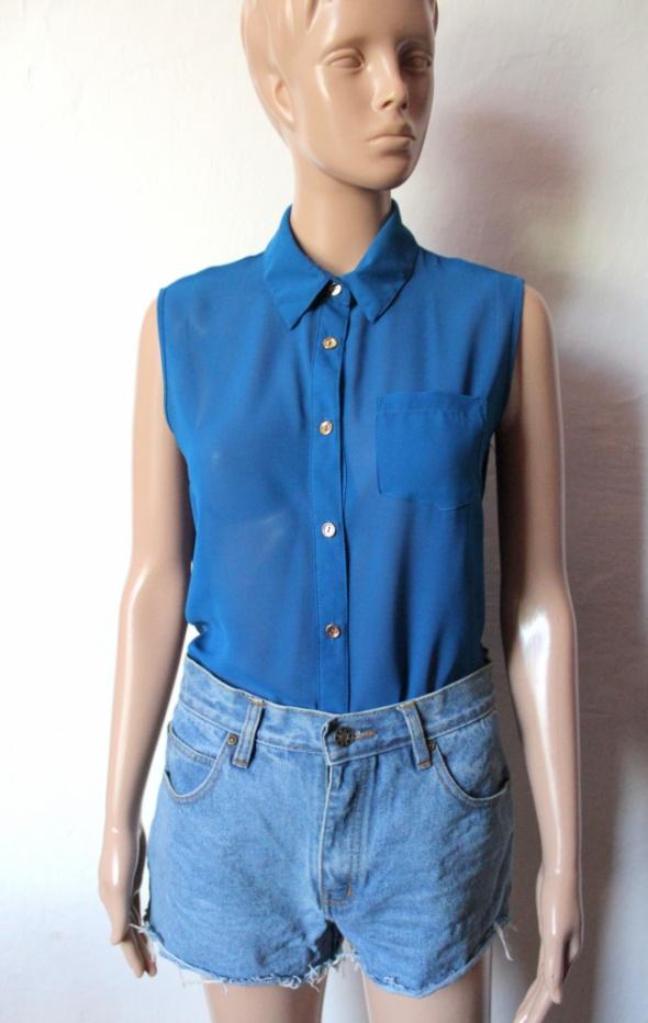 Niebieska koszula bez rękawów mgiełka r M