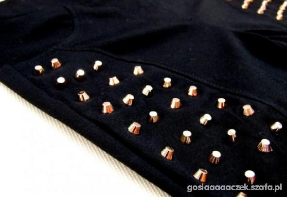 Spodnie ze złotymi ćwiekami