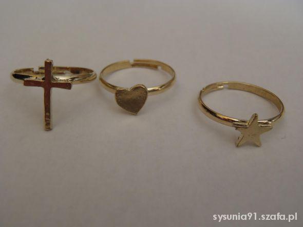 Trzy złote pierścionki krzyż serce gwiazda