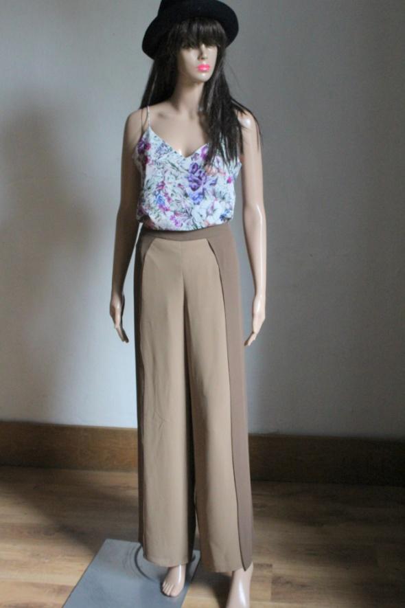 Eleganckie spodnie z wysokim stanem brązowe r około M...