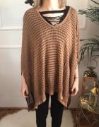 Karmelowy sweter ponczo...