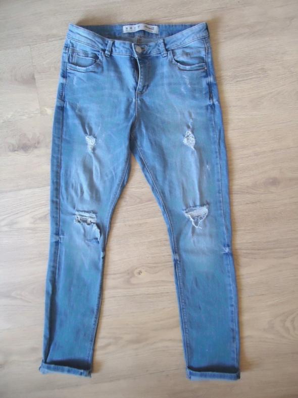 spodnie jeans dziury przetarcia M L jasne denim co