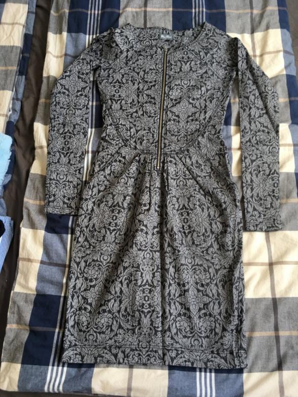 Pięknie zdobiona sukienka z zamkiem z przodu 36...
