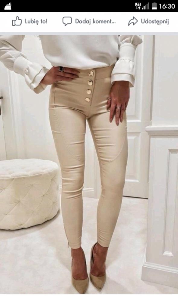 Spodnie kremowe