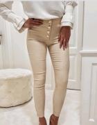 Spodnie kremowe...