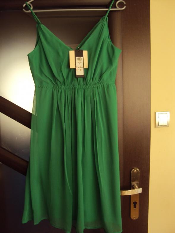 Śliczna sukienka Vila