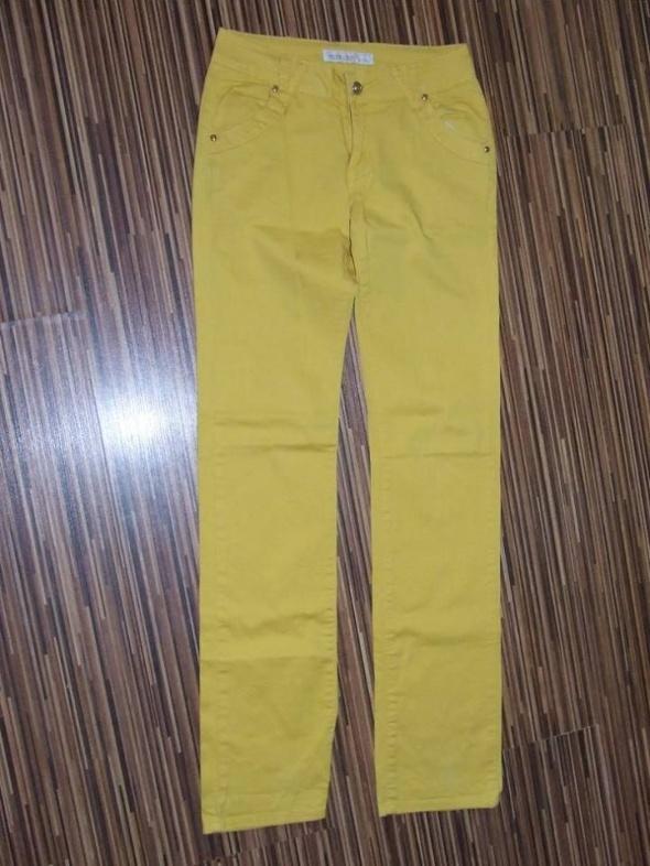 zolte spodnie jeans Miss Iteno rozmiar 26...
