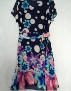 Sukienka z szyfonu rozkloszowana kreacja w kwiaty