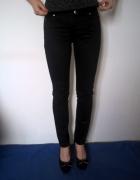 Czarne proste spodnie Orsay...