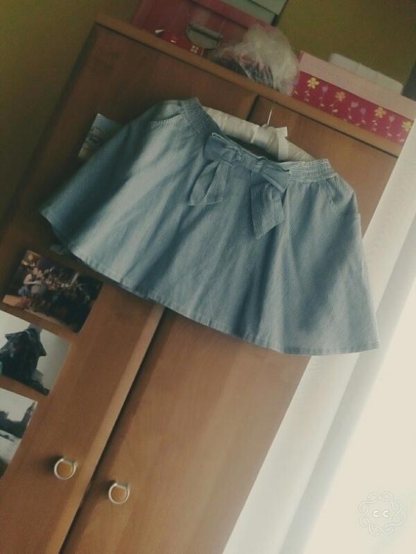 Spódnice Mini spódniczka rozkloszowana w paski z kokardą