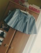 Mini spódniczka rozkloszowana w paski z kokardą...