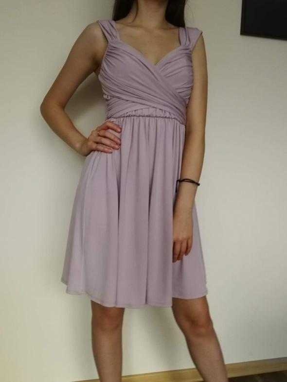 Delikatna kobieca Liliowa sukienka...