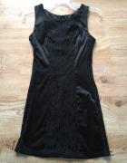 Czarna sukienka wyszczuplająca z koronką 36...