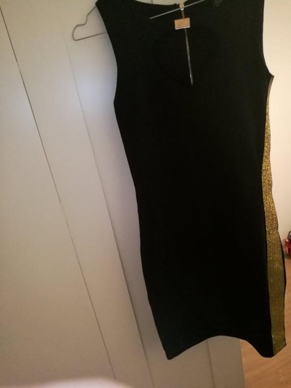 218f1832f2 Czarna obcisła sukienka ze złotymi elementami w Suknie i sukienki ...