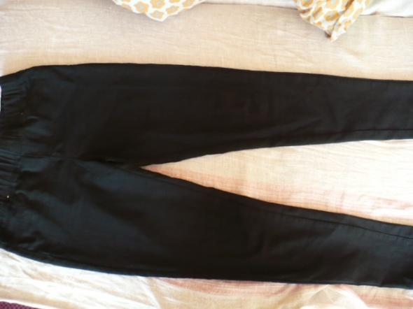 czarne modne leginsy tanio roz L